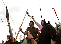 Spanish policemen try to protect a horseman (C) after a discord erupted during the bull of the plain 'Toro de la Vega' festival, on September 15, 2009 in Tordesillas. The festival is one of the oldest in Spain with roots dating back to the fifteenth century. The bull has to be enticed across the river from the village to the plain 'Vega' before it can be killed to honour the 'Virgen de la Pena'.   © Pedro ARMESTRE.
