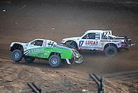 Dec. 11, 2011; Chandler, AZ, USA;  LOORRS pro 2 driver Jeff Geiser (44) and Carl Renezeder (17) during the Lucas Oil Challenge Cup at Firebird International Raceway. Mandatory Credit: Mark J. Rebilas-
