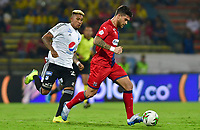 MEDELLIN - COLOMBIA, 07-03-2020: Adrian Arregui del Medellín disputa el balón con Jose G Ortiz de Millonarios durante partido entre Independiente Medellín y Millonarios por la fecha 8 de la Liga BetPlay I 2020 jugado en el estadio Atanasio Giardot de la ciudad de Medellín. / Adrian Arregui of Medellin vies the ball with Jose G Ortiz of Millonarios during match between Independiente Medellin and Millonarios for the date 8 as part of BetPlay League I 2020 played at Atanasio Girardot stadium in Medellin. Photo: VizzorImage / León Monsalve / Cont /