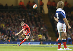 Wales full back Leigh Halfpenny attempts a long range penalty kick.<br /> RBS 6 Nations 2014<br /> Wales v France<br /> Millennium Stadium<br /> 21.02.14<br /> <br /> ©Steve Pope-SPORTINGWALES