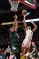 COLLEGE PARK, MD - FEBRUARY 03: Shakira Austin #1 of Maryland banks in a shot over Cydni Dodd #50 of Michigan State during a game between Michigan State and Maryland at Xfinity Center on February 03, 2020 in College Park, Maryland.