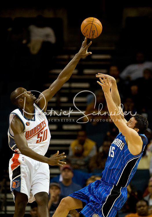 Charlotte Bobcats center Emeka Okafor (50) shoots the ball over Orlando Magic forward Hedo Turkoglu (15) during an NBA basketball game at Time Warner Cable Arena in Charlotte, NC.