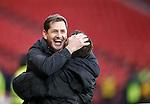 Jackie McNamara hugs coach Darren Jackson as the final whistle puts Dundee Utd through to the final