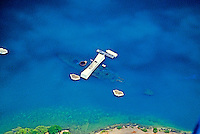 Amazing aerial shot of famous Arizona Memorial  at Pearl Harbor on Oahu. Ghostly USS Arizona is clearly visible in the blue water under the tourist center.