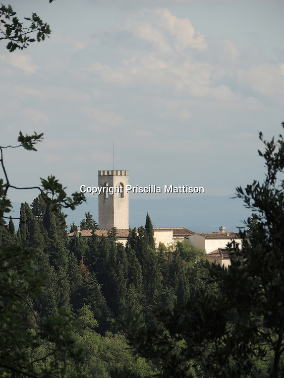 Val d'Arno, Italy - October 2, 2012:  Light and dark sides of the  tower of Chiesa di San Cristoforo in Perticaia.