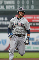 Colorado Springs Sky Sox catcher Manny Pina (9) races to third base during a Pacific Coast League game against the Iowa Cubs on May 1st, 2016 at Principal Park in Des Moines, Iowa.  Colorado Springs defeated Iowa 4-3. (Brad Krause/Four Seam Images)