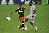 WASHINGTON, DC - SEPTEMBER 12: Kevin Paredes #30 of D.C. United battles for the ball with Dru Yearwood #16 of New York Red Bulls during a game between New York Red Bulls and D.C. United at Audi Field on September 12, 2020 in Washington, DC.