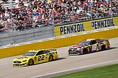 #22: Joey Logano, Team Penske, Ford Mustang Pennzoil and #18: Kyle Busch, Joe Gibbs Racing, Toyota Camry M&M's Chocolate Bar