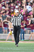 Referee Tom Ritter signals to start the clock during first half of an NCAA Football game, Saturday, October 04, 2014 in San Marcos, Tex. Texas State leads Idaho 21-3 at the halftime(Mo Khursheed/TFV Media via AP Images)