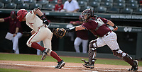 UALR catcher John Michael Russ (right) reaches Wednesday, April 7, 2021, to tag out Arkansas right fielder Cayden Wallace to complete the strikeout during the first inning of the Razorbacks' 10-3 win over UALR at Baum-Walker Stadium in Fayetteville. Visit nwaonline.com/210408Daily/ for today's photo gallery. <br /> (NWA Democrat-Gazette/Andy Shupe)
