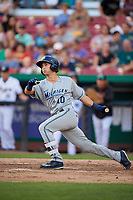 West Michigan Whitecaps left fielder Garrett McCain (10) follows through on a swing during a game against the Kane County Cougars on July 19, 2018 at Northwestern Medicine Field in Geneva, Illinois.  Kane County defeated West Michigan 8-5.  (Mike Janes/Four Seam Images)