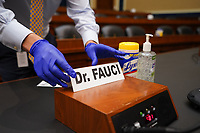 The name tag for Dr. Anthony  Fauci,  the Director of the National Institute for Allergy and Infectious Diseases, is placed at his seat before he arrives to testify before the House Committee on Energy and Commerce on the Trump Administration's Response to the COVID-19 Pandemic, on Capitol Hill in Washington, DC on Tuesday, June 23, 2020.    <br /> Credit: Kevin Dietsch / Pool via CNP/AdMedia