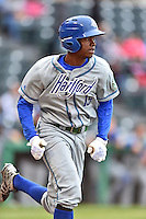 Hartford Yard Goats right fielder Raimel Tapia (15) runs to first during a game against the Richmond Flying Squirrels at The Diamond on April 30, 2016 in Richmond, Virginia. The Yard Goats defeated the Flying Squirrels 5-1. (Tony Farlow/Four Seam Images)