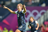 Glasgow, Scotland - July 25, 2012: Alex Morgan runs to her teammates after scoring her first goal of the opening game for the US Womens' Soccer Team at the London Olympics