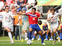Leonardo Gonzalez (12) of Costa Rica holds off Ireneusz Jelen (21) and Miroslav Szymkowiak (10) of Poland. Poland got its only win of the tourament 2-1 over winless Costa Rica at FIFA World Cup stadium in Hannover, June 20 2006.