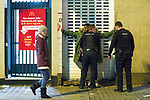 """© Joel Goodman - 07973 332324 . 15/12/2017. Manchester, UK. Police stop and search a man outside McDonalds in Piccadilly Gardens . Revellers out in Manchester City Centre overnight during """" Mad Friday """" , named for historically being one of the busiest nights of the year for the emergency services in the UK . Photo credit : Joel Goodman"""