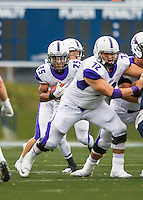 8 October 2016: Amherst College Purple & White Wide Running Back Hasani Figueroa, a Junior from Bronx, NY, looks for an opening and yardage against the Middlebury College Panthers at Alumni Stadium in Middlebury, Vermont. The Panthers edged out the Purple & While 27-26. Mandatory Credit: Ed Wolfstein Photo *** RAW (NEF) Image File Available ***