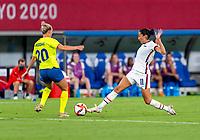 TOKYO, JAPAN - JULY 21: Julia Roddar #20 of Sweden defends Christen Press #11 of the USWNT during a game between Sweden and USWNT at Tokyo Stadium on July 21, 2021 in Tokyo, Japan.
