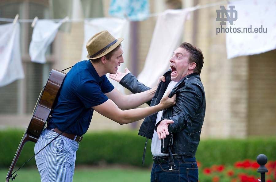 """Aug, 26, 2013; Actors from the Young Company, Jess Alexander and Will Freske, perform in Shakespeare's """" The Comedy of Errors"""" on the Main Building Quad (in front of the Golden Dome). Photo by Barbara Johnston/University of Notre Dame"""