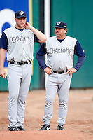 June 29, 2009:  Pitching Coach Richard Dotson of the Charlotte Knights talks with Adam Russell before a game at Coca-Cola Field in Buffalo, NY.  The Knights are the International League Triple-A affiliate of the Chicago White Sox.  Photo by:  Mike Janes/Four Seam Images