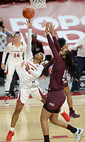 Arkansas guard Makayla Daniels (left) reaches to score Thursday, Feb. 11, 2021, as Mississippi State forward Sidney Cooks (right) defends during the first half of play in Bud Walton Arena. Visit nwaonline.com/210212Daily/ for today's photo gallery. <br /> (NWA Democrat-Gazette/Andy Shupe)