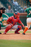 Lakewood BlueClaws catcher Gregori Rivero (23) awaits the pitch in front of home plate umpire John Budka during a game against the Greensboro Grasshoppers on June 10, 2018 at First National Bank Field in Greensboro, North Carolina.  Lakewood defeated Greensboro 2-0.  (Mike Janes/Four Seam Images)