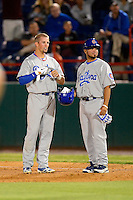 Daytona Cubs second baseman Tim Saunders #3 and coach Nate Maldonado #19 during a game against the Brevard County Manatees at Spacecoast Stadium on April 5, 2013 in Viera, Florida.  Daytona defeated Brevard County 8-0.  (Mike Janes/Four Seam Images)