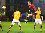 Motherwell v St Johnstone.....01.01.14   SPFL<br /> Scott Brown heads clear from Stuart Carswell<br /> Picture by Graeme Hart.<br /> Copyright Perthshire Picture Agency<br /> Tel: 01738 623350  Mobile: 07990 594431
