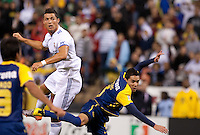 Cristiano Ronaldo (left) watches his header miss the mark, over Oscar Rojas (right). Real Madrid defeated Club America 3-2 at Candlestick Park in San Francisco, California on August 4th, 2010.