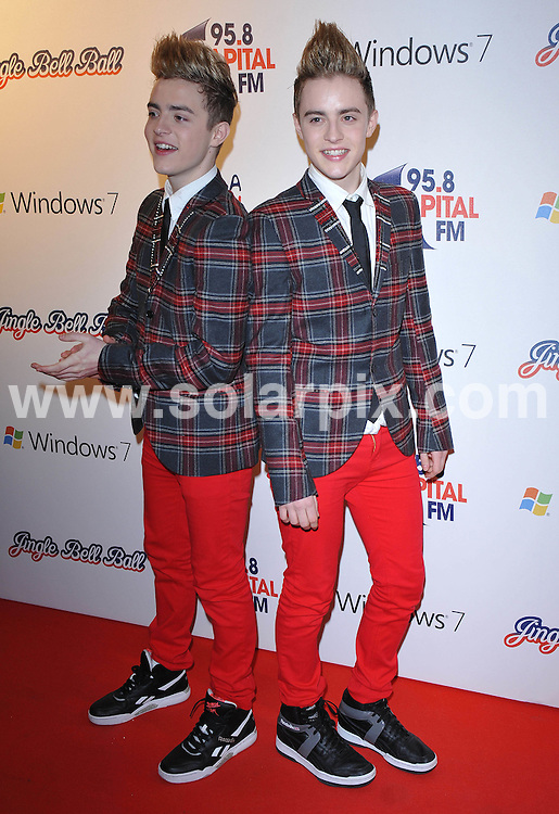 **ALL ROUND PICTURES FROM SOLARPIX.COM**.**WORLDWIDE SYNDICATION RIGHTS**.Press room at the Jinglebell Ball 2009. Held at the O2 Arena, Greenwich Peninsula in London UK..This pic:John & Edward Grimes..JOB REF: 10346      SSD     DATE:06.12.09.**MUST CREDIT SOLARPIX.COM OR DOUBLE FEE WILL BE CHARGED**.**MUST NOTIFY SOLARPIX OF ONLINE USAGE**.**CALL US ON: +34 952 811 768 or LOW RATE FROM UK 0844 617 7637**