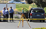 "Officials investigate the scene after a gunman opened fire with an AK-47 in an IHOP restaurant in Carson City, Nev., on Tuesday, Sept. 6, 2011. The gunman killed three people, including two Nevada National Guard members, and injured six others before shooting himself. The suspect's van, right, has a ""Support Our Troops"" magnet on the rear. (AP Photo/Cathleen Allison)"
