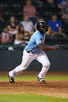 Tyreque Reed (37) of the Hickory Crawdads follows through on his swing against the Charleston RiverDogs at L.P. Frans Stadium on August 10, 2019 in Hickory, North Carolina. The RiverDogs defeated the Crawdads 10-9. (Brian Westerholt/Four Seam Images)