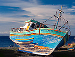 Colorful wooden fishing boat at Punta Arenas-regarded as the world's southernmost city, on the Strait of Magellan, Chile, South America