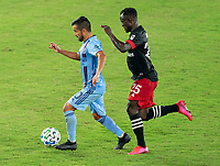 WASHINGTON, DC - SEPTEMBER 06: Maximiliano Moralez #10 of New York City FC passes the ball while being defended by Mohammed Abu #25 of D.C. United during a game between New York City FC and D.C. United at Audi Field on September 06, 2020 in Washington, DC.