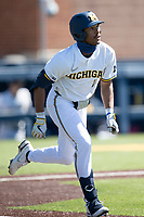 Michigan Wolverines outfielder Clark Elliott (15) runs to first base during the NCAA baseball game against the Illinois Fighting Illini on March 20, 2021 at Fisher Stadium in Ann Arbor, Michigan. Michigan won the game 8-1. (Andrew Woolley/Four Seam Images)