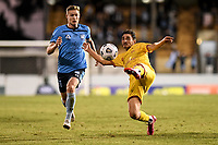 18th April 2021; Leichardt Oval, Sydney, New South Wales, Australia; A League Football, Sydney Football Club versus Adelaide United; Ryan Kitto of Adelaide United stretches to clear the ball as Harry Van Der Saag of Sydney approaches