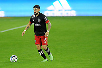WASHINGTON, DC - OCTOBER 28: Junior Moreno #5 of D.C. United moves the ball during a game between Columbus Crew and D.C. United at Audi Field on October 28, 2020 in Washington, DC.