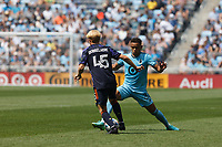ST PAUL, MN - JULY 18: Hassani Dotson #31 of Minnesota United FC and Ethan Dobbelaere #45 of the Seattle Sounders FC battle for the ball during a game between Seattle Sounders FC and Minnesota United FC at Allianz Field on July 18, 2021 in St Paul, Minnesota.