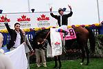 Joshua Tree (IRE)(8) with Jockey Lanfranco Dettori celebrates victory at Pattison Canadian International  in Toronto, Canada on October 14, 2012.
