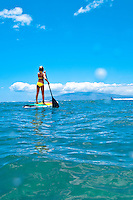 Young woman standup paddle boarding, Makena, southwest Maui