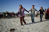 Pacific Grove, California<br /> January 26, 2014<br /> <br /> Following the Ecofarm conference at the Asilomar conference grounds, organic farmers take to the Asilomar State Beach and hold a rain dance hoping to break the drought that has hit the region. <br /> <br /> Two weeks later it rained in California.