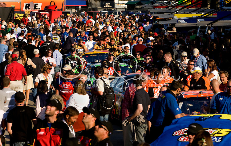 Fans walk through the garage during the Bank of America 500 NASCAR race at Lowes's Motor Speedway in Concord, NC.