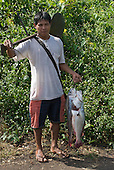 Pará State, Brazil. Aldeia Apyterewa (Parakana). Happy fisherman.