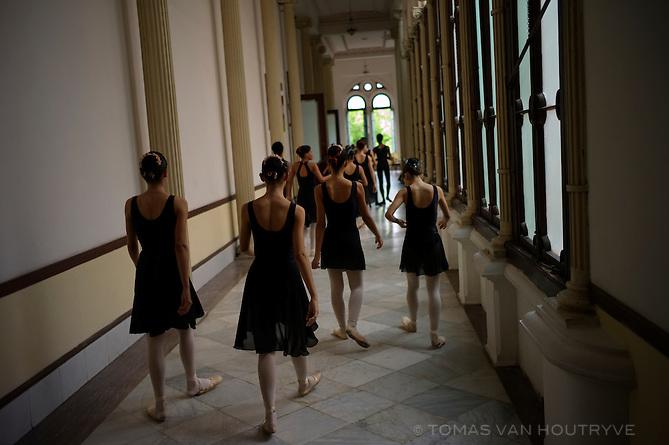 "Ballet students of ""Escuela Nacional Cubana de Ballet,"" Cuban National Ballet School, walk down the hall after a class in Havana, Cuba on Nov. 4, 2010."