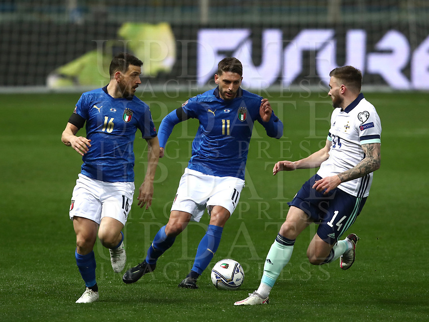 Footbal Soccer: FIFA World Cup Qatar 2022 Qualification, Italy - Northern Ireland, Ennio Tardini stadium, Parma, March 26, 2021.<br /> Italy's Domenico Berardi (C) in action with Italy's Alessandro Florenzi (L) and Northern Ireland (L) Stuart Dallas (R) during the FIFA World Cup Qatar 2022 qualification, football match between Italy and Northern Ireland, at Ennio Tardini stadium in Parma on March 26, 2021.<br /> UPDATE IMAGES PRESS/Isabella Bonotto