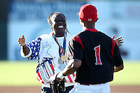 Denean Howard Hill goes to hug her son Virgil Hill, an outfielder with the Batavia Muckdogs after throwing out the first pitch before a game against the Mahoning Valley Scrappers at Dwyer Stadium on July 4, 2011 in Batavia, New York.  Howard-Hill is a former Olympic Track & Field Gold Medalist.  Batavia defeated Mahoning Valley 3-2.  (Mike Janes/Four Seam Images)