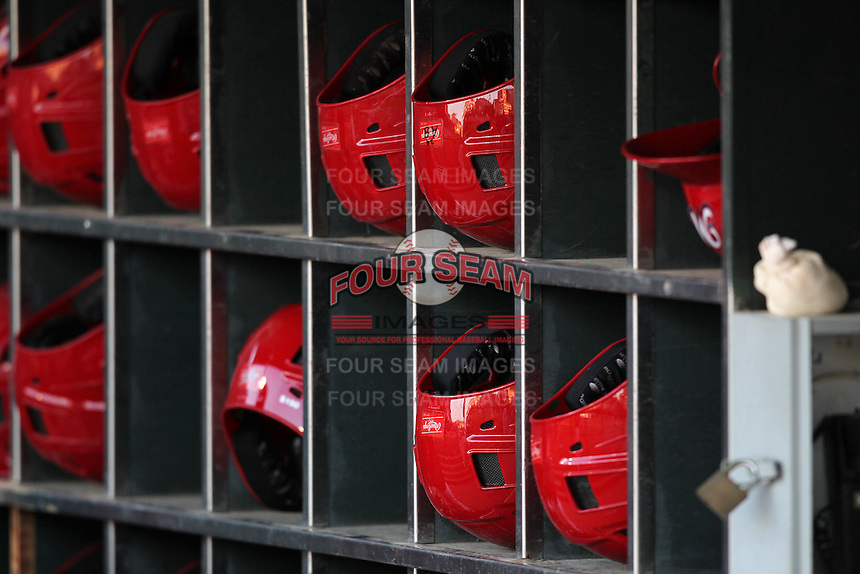 Memphis Redbirds helmet rack before a game versus the Round Rock Express at Autozone Park on April 28, 2011 in Memphis, Tennessee.  Memphis defeated Round Rock by the score of 6-5 in ten innings.  Photo By Mike Janes/Four Seam Images