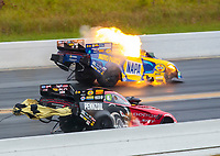 Sep 27, 2020; Gainesville, Florida, USA; NHRA funny car driver Ron Capps explodes an engine on fire alongside Matt Hagan during the Gatornationals at Gainesville Raceway. Mandatory Credit: Mark J. Rebilas-USA TODAY Sports
