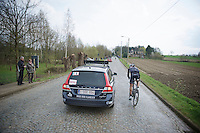 Stijn Devolder (BEL/Trek Factory Racing) checking in with the doctor while trying to get back to the peloton after he crashed hard just 2 minutes ago<br /> <br /> Dwars Door Vlaanderen 2014