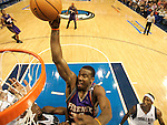 Phoenix's Amare Stoudemire goes for a dunk against Erick Dampier, left, and Josh Howard during an NBA basketball playoff game between the Dallas Mavericks and the Phoenix Suns on Friday, May 20, 2005. (photo by Khampha Bouaphanh
